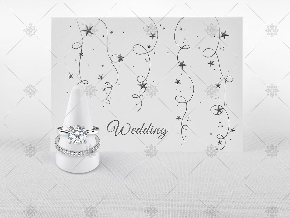 Wedding day card and diamond rings
