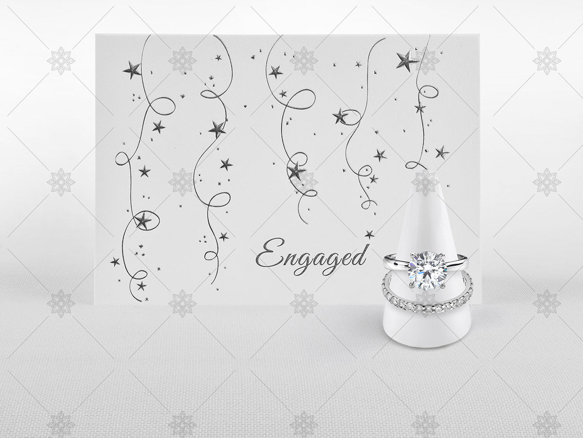 engaged card and diamond rings