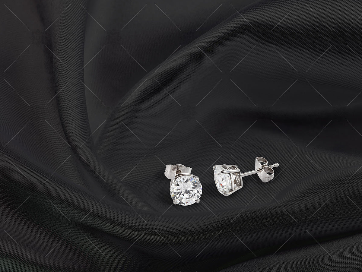 diamond stud earrings on black silk