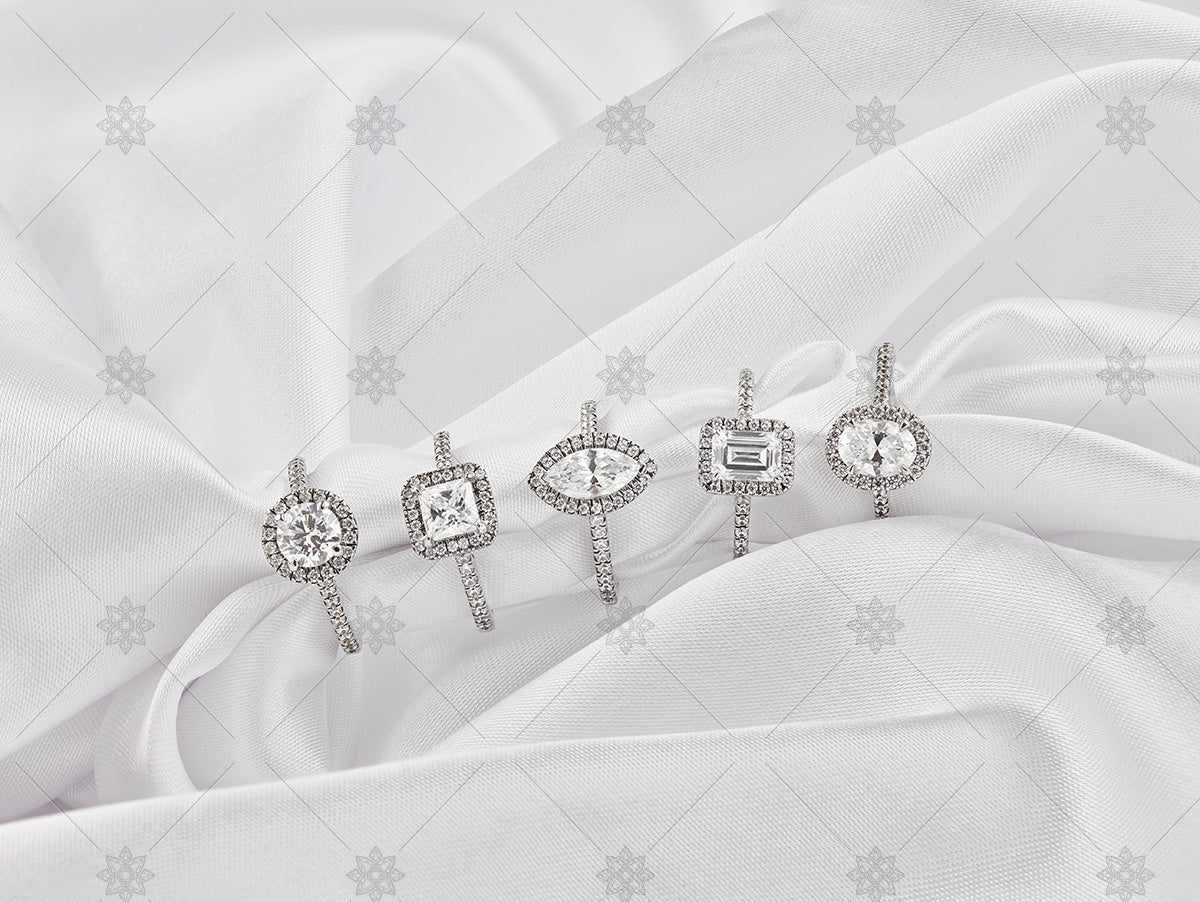diamond cluster rings on white silk