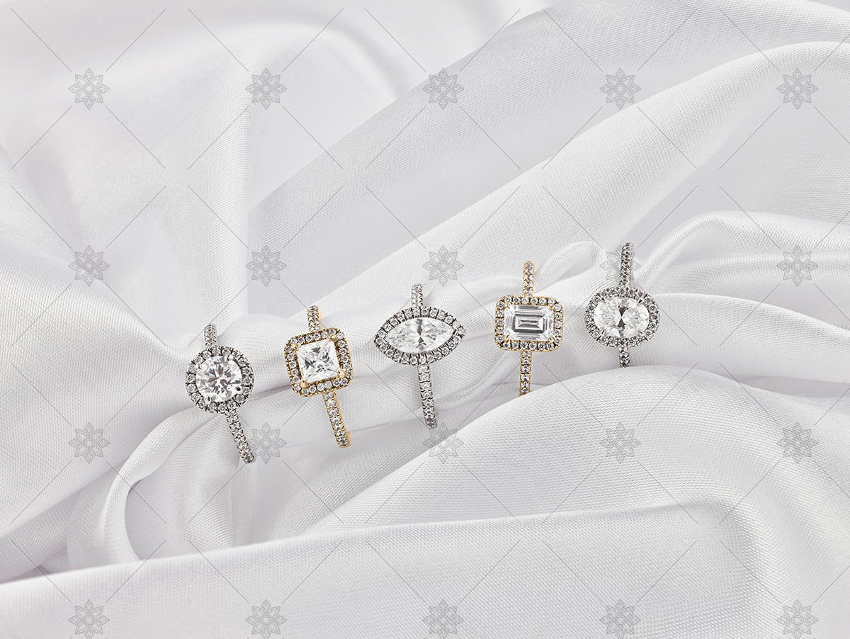gold diamond cluster rings on white silk background