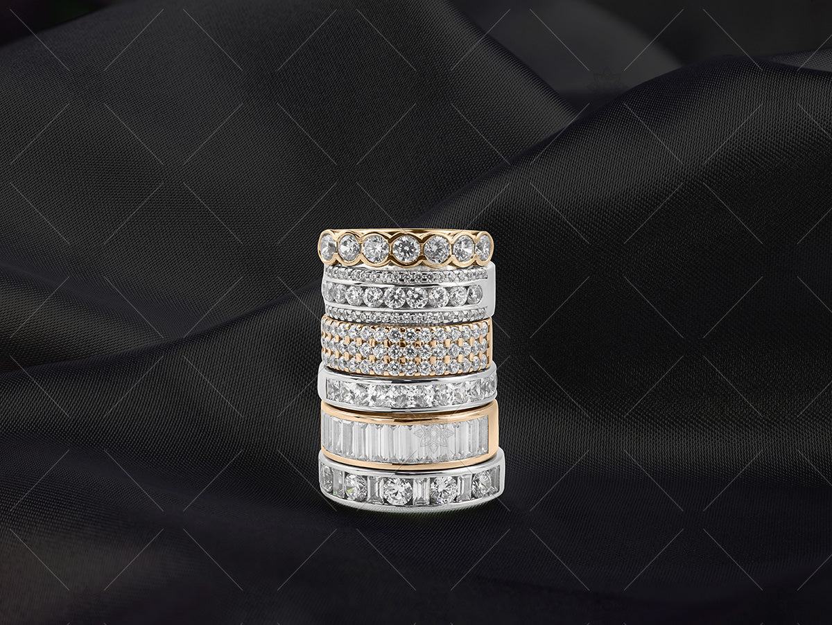 gold eternity ring stack on black silk
