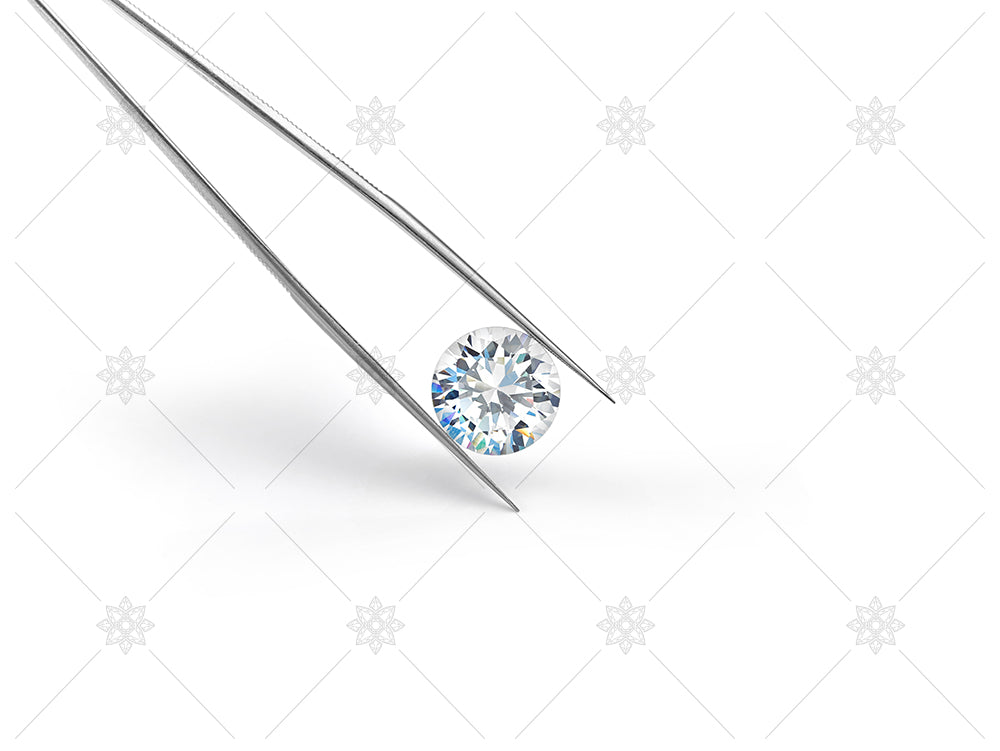 Diamond and tweezers on white background