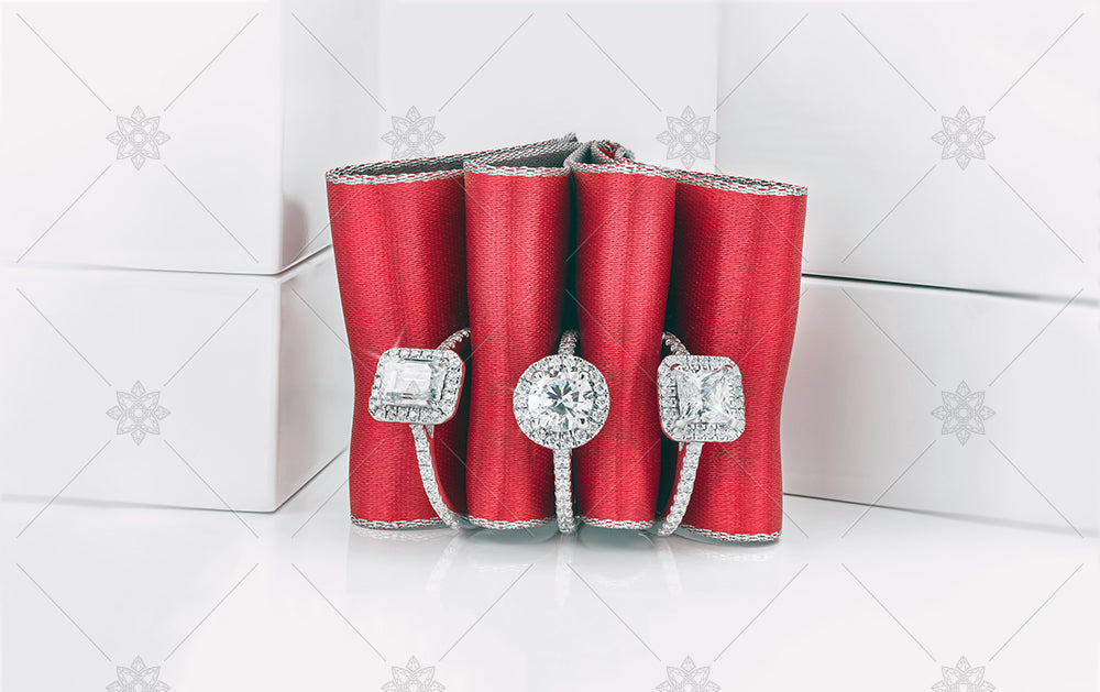 Red ribbon and diamond halo rings