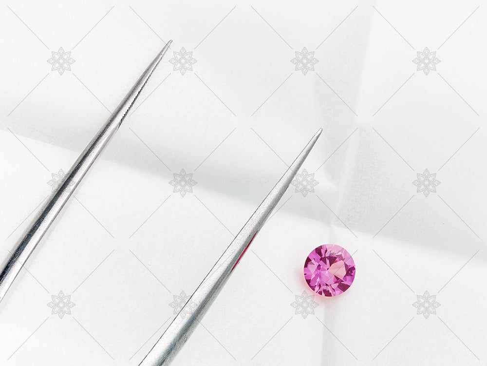 Pink sapphire and tongs