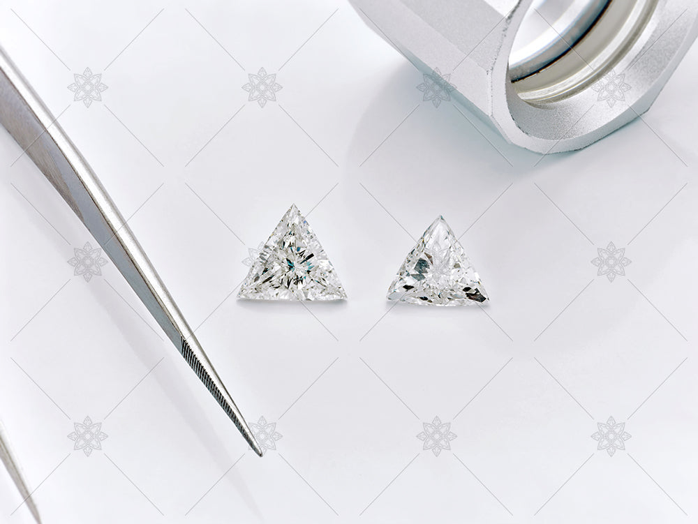 Trilliant Diamonds with tongs