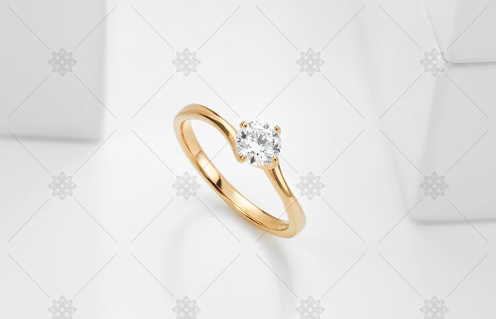 4 claw twist solitaire ring in rose gold