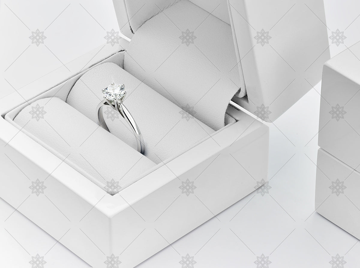 White gold diamond ring in a white jewellery box