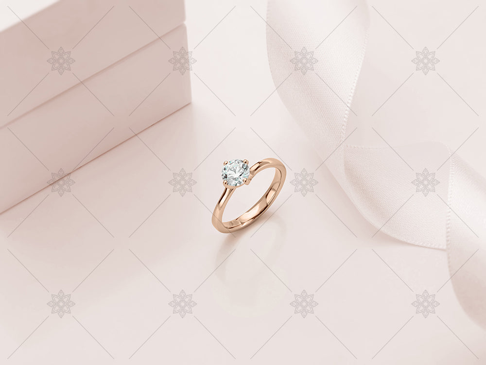 rose gold ring on tinted background