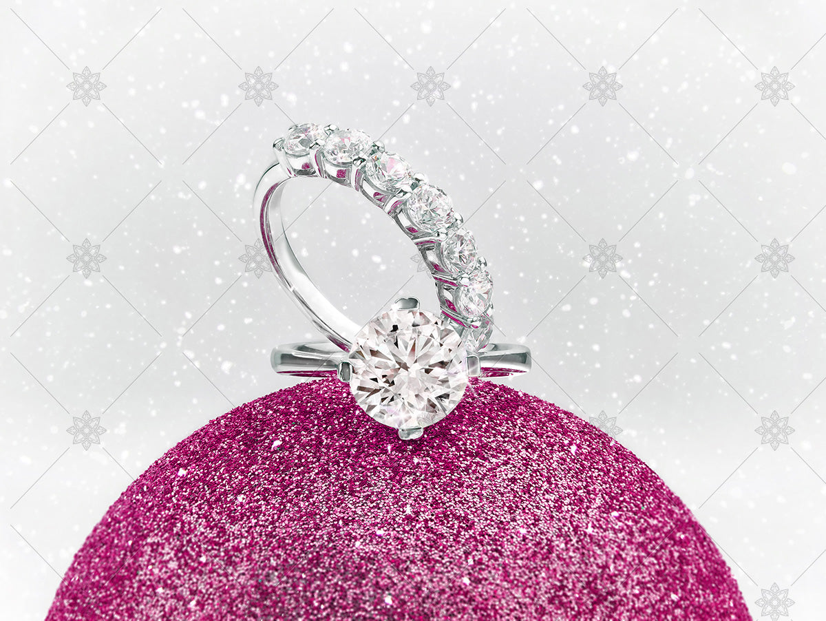 christmas diamond rings on winter sparkly bauble