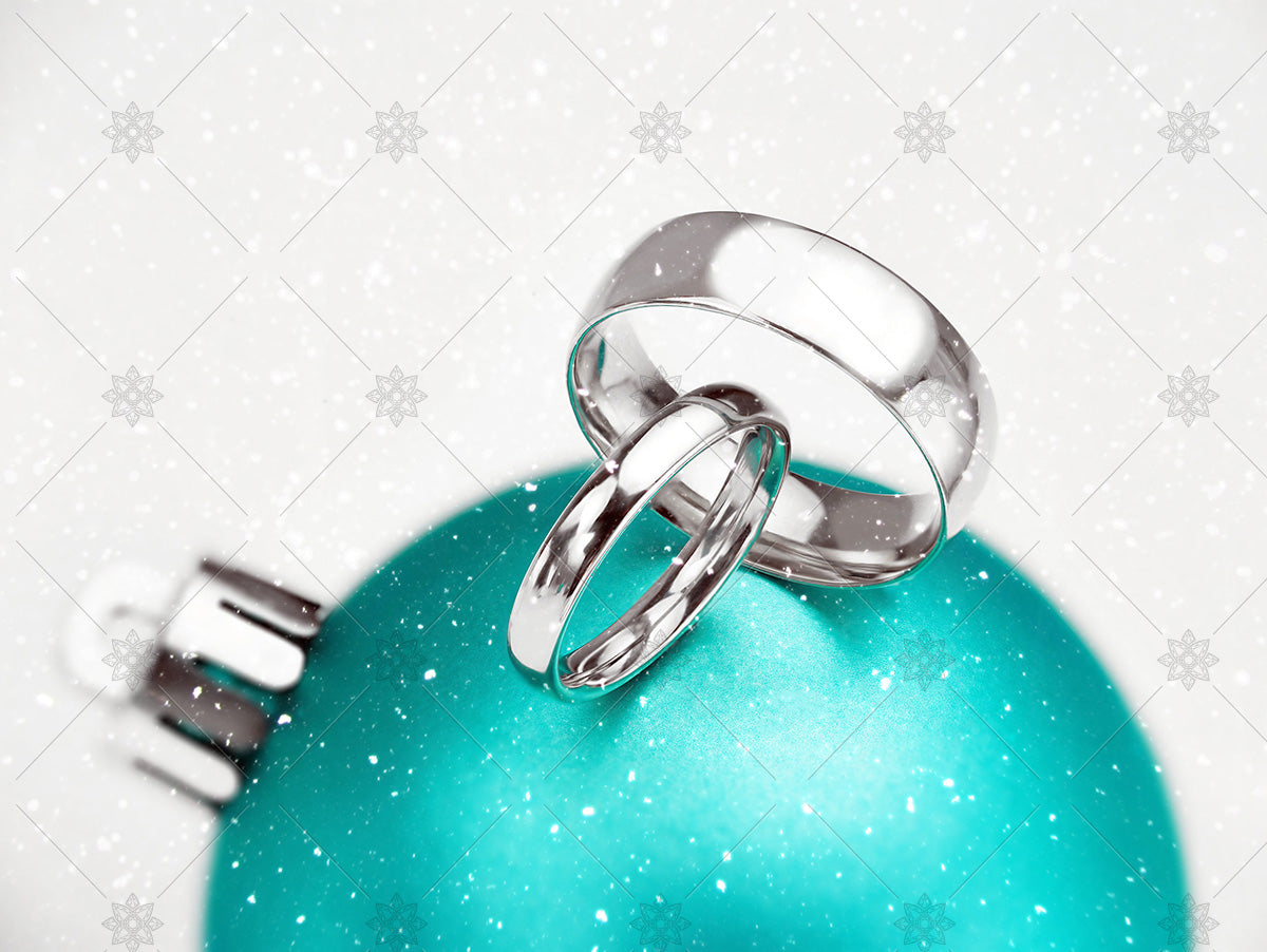 winter wedding rings on green bauble