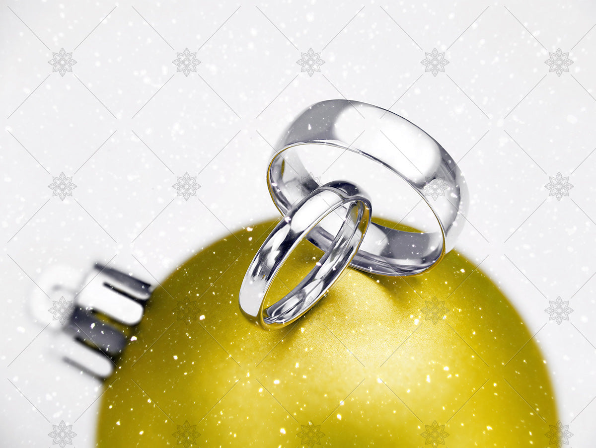Winter wedding rings on yellow bauble