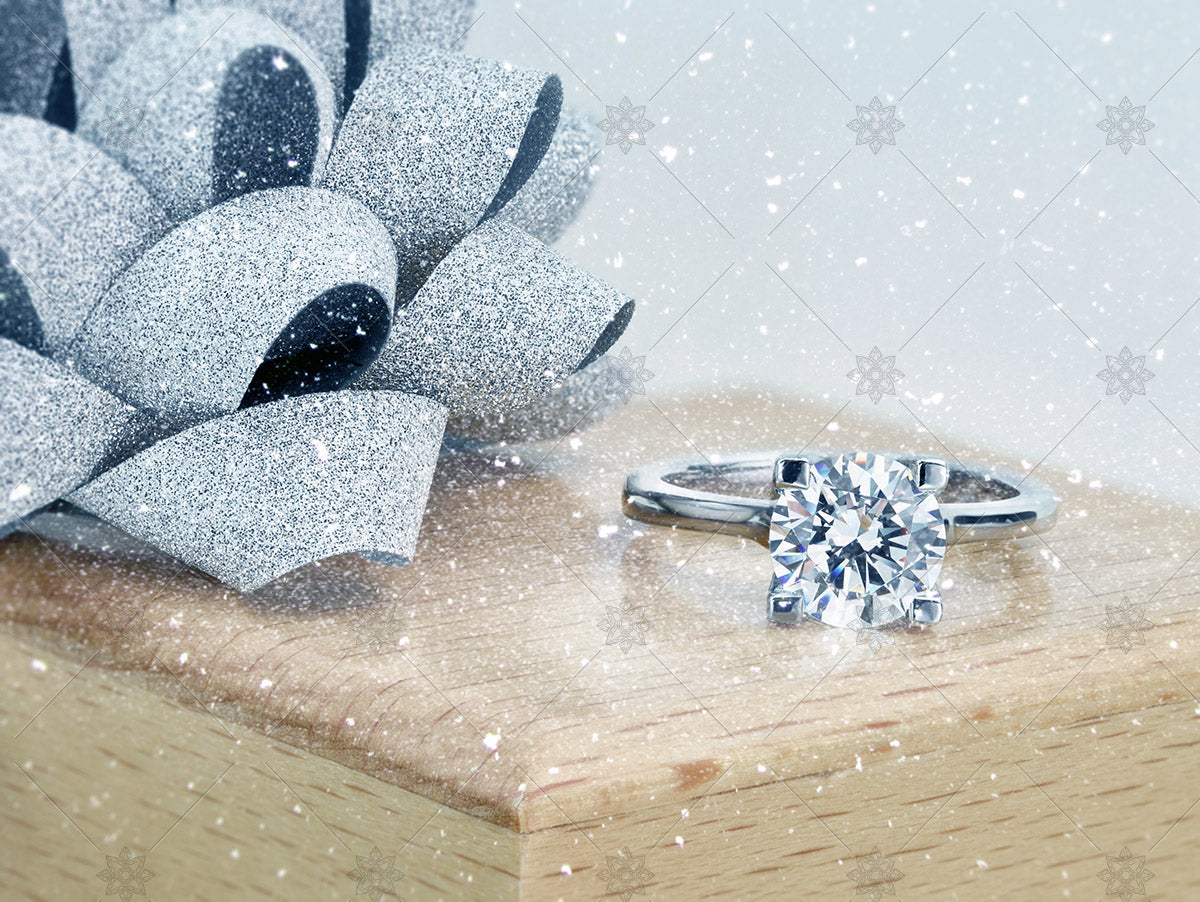 winter ring box ribbon and diamond solitaire