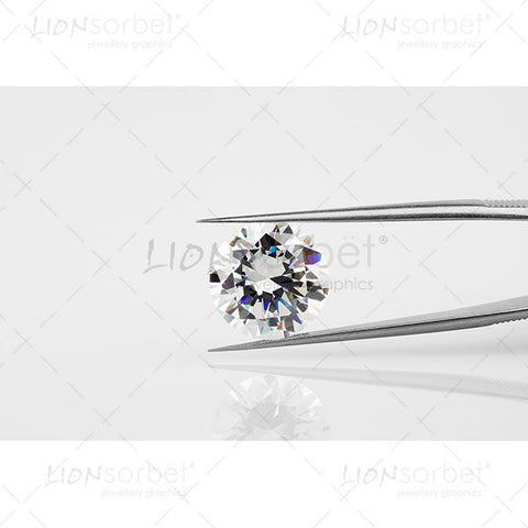 Round Diamond held in steel tongs