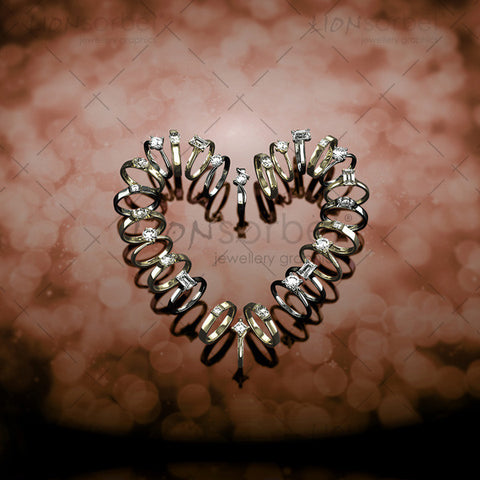 Image of engagement rings making a heart shape