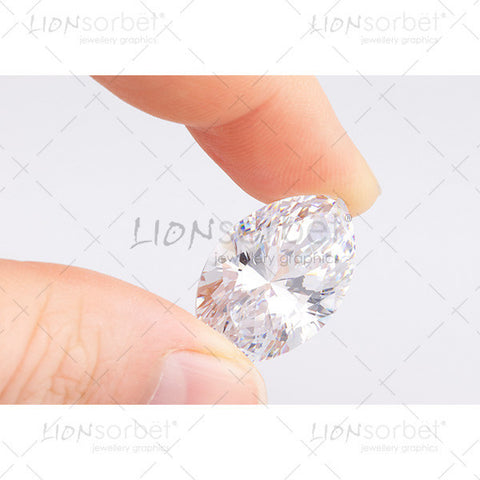 marquise diamond held in fingers