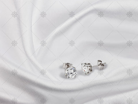 Diamond Stud earrings on white silk - NC1006