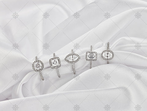 Diamond cluster rings on white silk - NC1011
