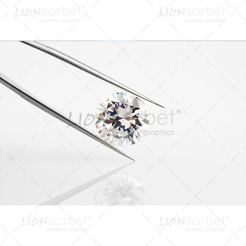 diamond in metal tongs
