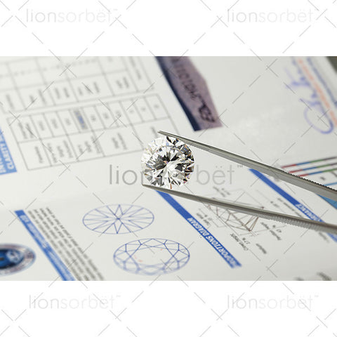 diamond in tweezers with certification