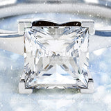 Princess cut, Square Solitaire Diamond Ring on with seasonal themed background