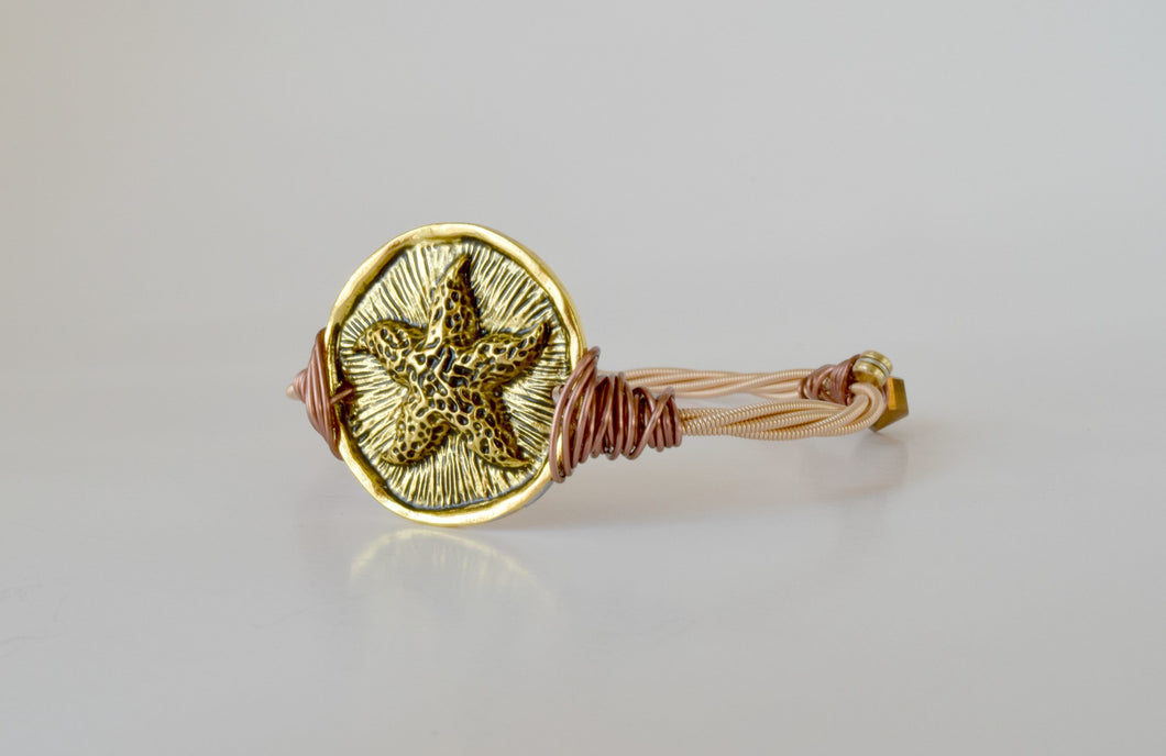 Golden Starfish Guitar String Bangle