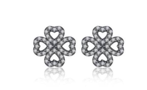 Clover ear studs encrusted in crystals