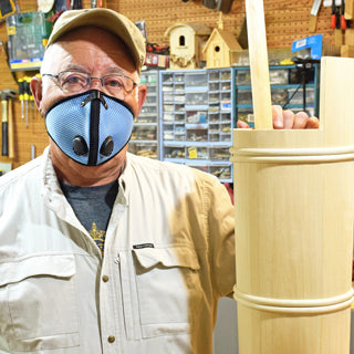 Woodworker wearing a M2 mask in Sky posing in his shop