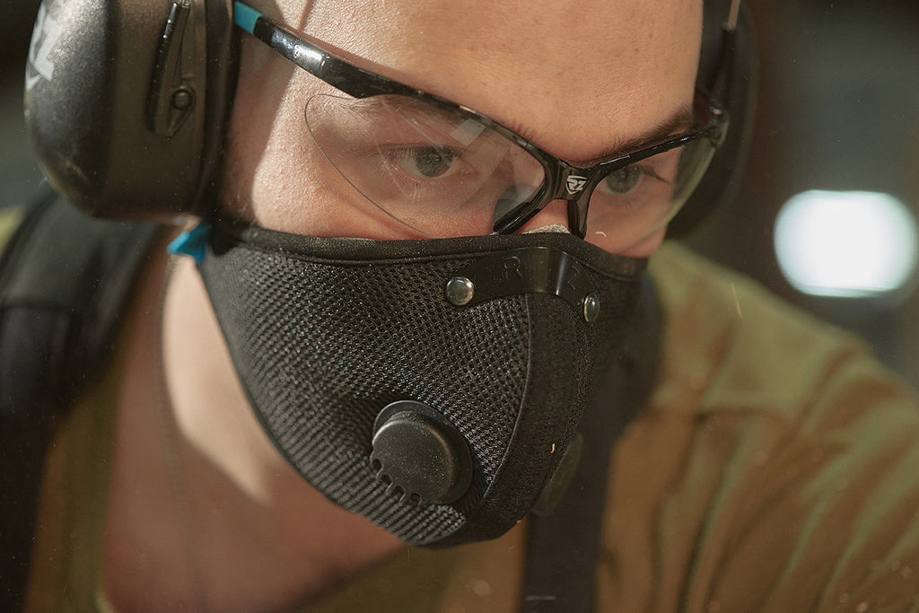 Man wearing safety glasses and mask