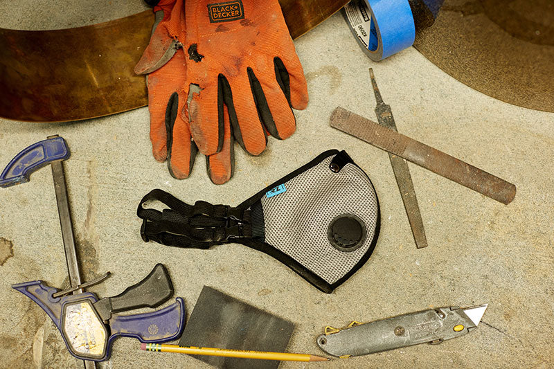 Various tools on table with RZ dust mask centered
