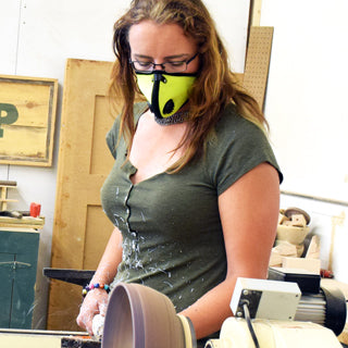 Woman Woodturning while wearing Safety Green RZ M2 mask