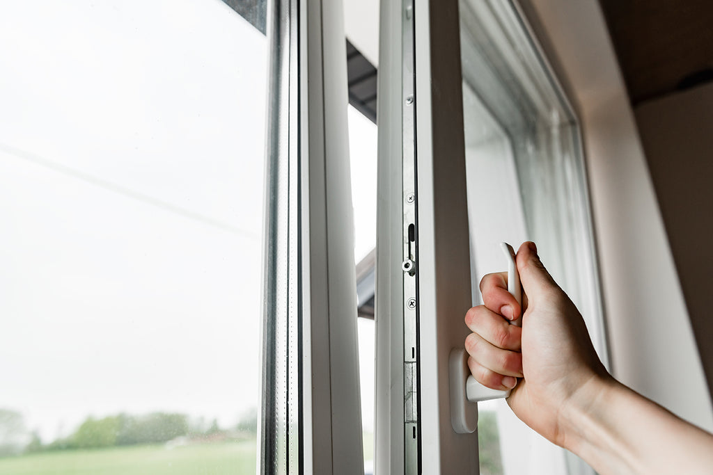 Handing closing window to prevent smoke from getting into home.