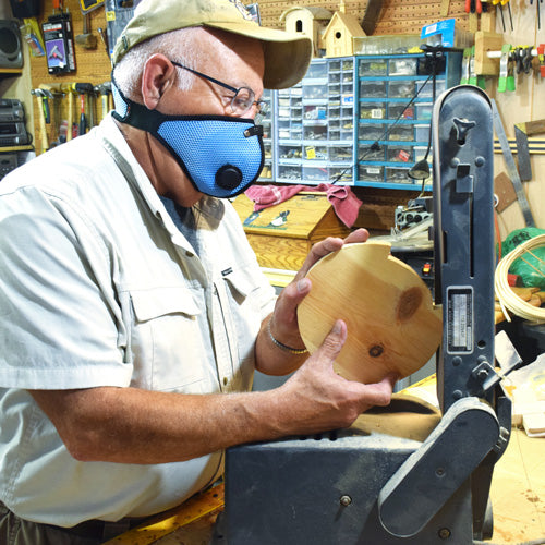 Woodworker in shop with RZ mask