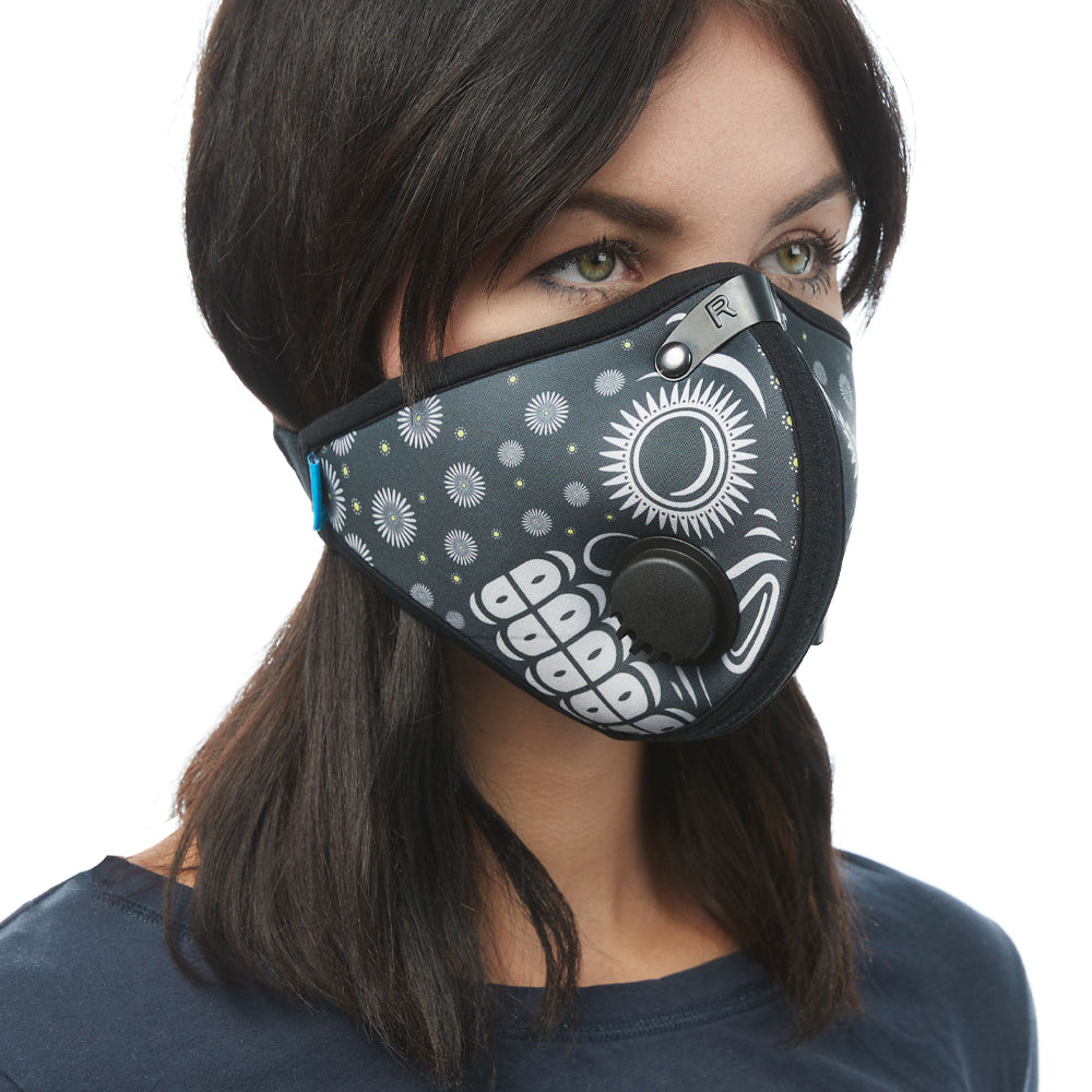 Angled view of woman wearing RZ M2 Nylon Day of the Dead Black mask shell