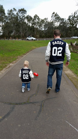Matching father and son college varsity jackets