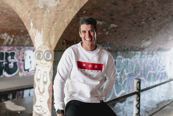 Model wearing ROQ Red Crew Jumper in underground graffiti area in Melbourne