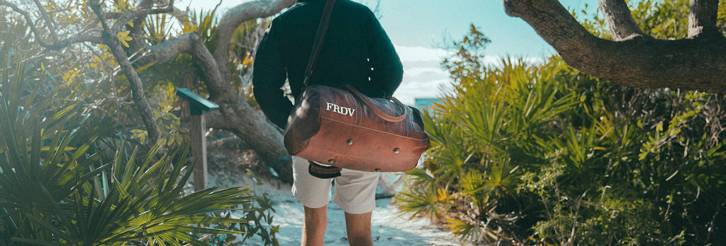 MAHI Leather Classic Duffle in Vintage Brown at the Beach | Photo by Erick Dent