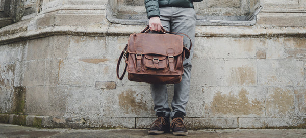Man holding the Vintage Brown Harvard Satchel