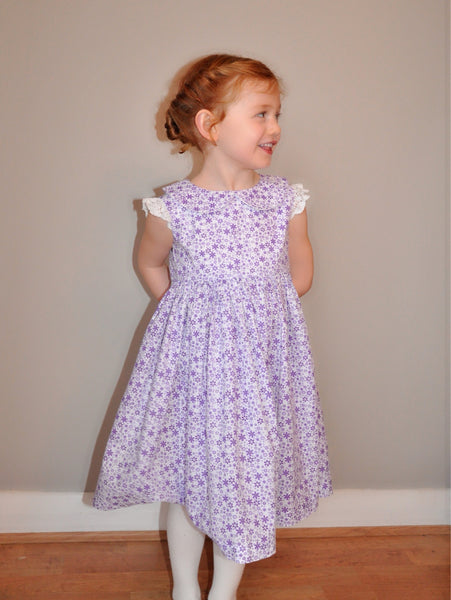 Girls dress handmade in a purple disty floral print with a lace sleeve 'Ditsy Violet'