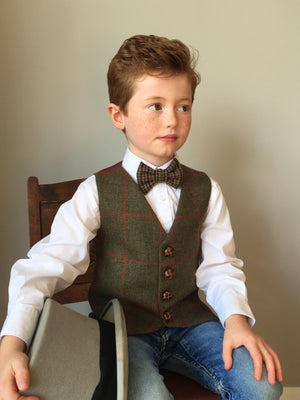 'Caractacus Potts' Boys waistcoat handmade in an opulent British olive green wool with a rich red check