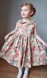 Girls dress handmade in a large pink and green floral print 'Garden Party'