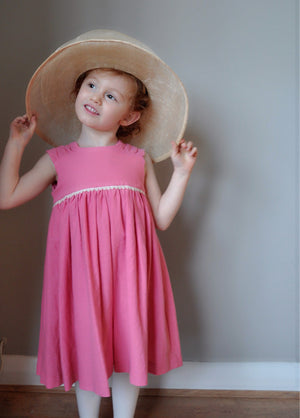 Girls dress handmade in bright pink with a crochet empire trim and rushed shoulder detail 'Candy Floss Isla'