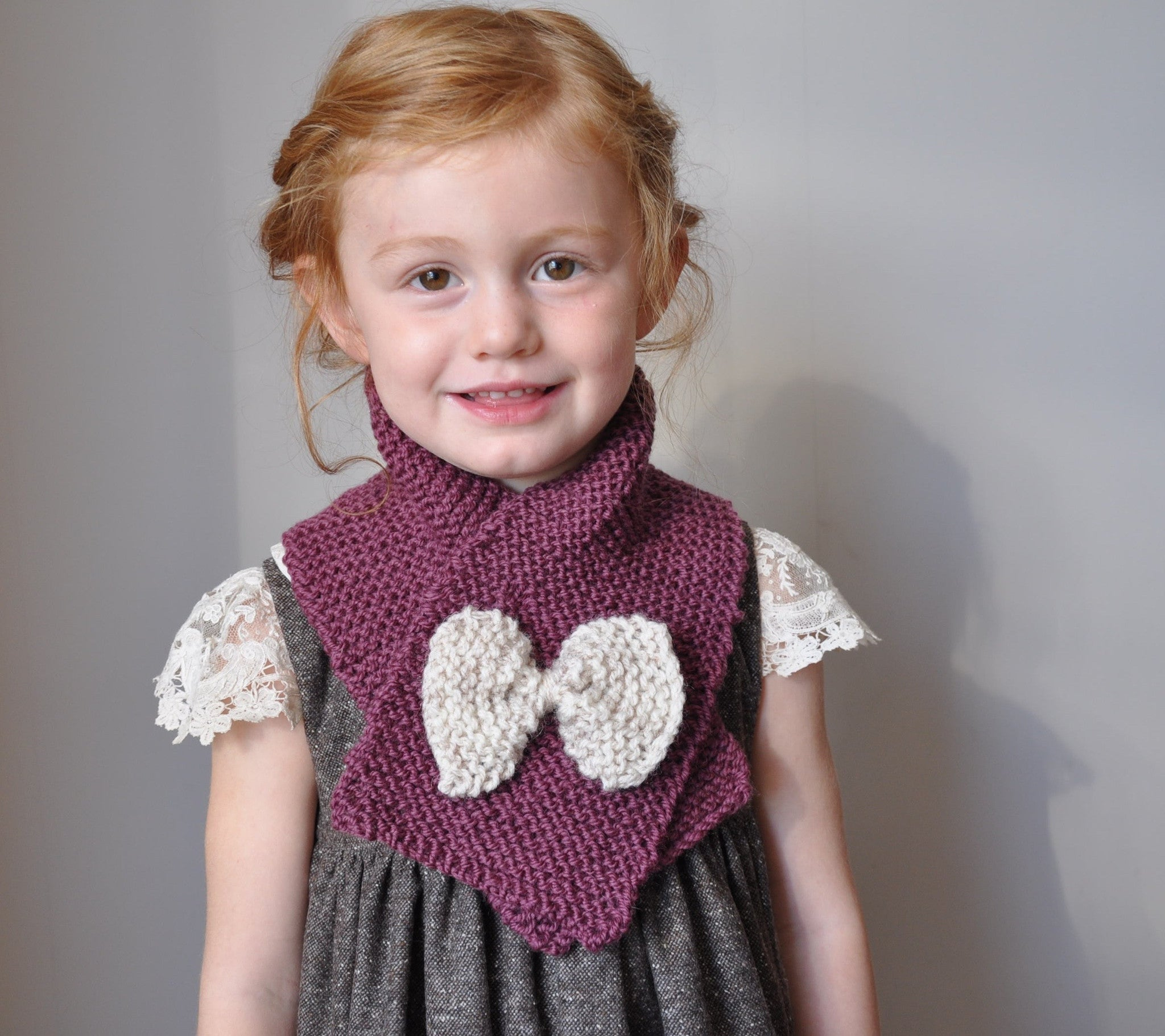 Hand knit scarf in rich berry with cream bow