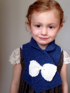 Hand knit scarf in deep blue with white bow