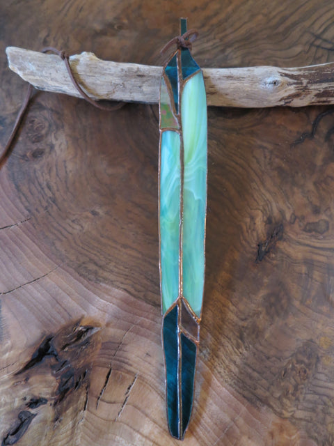 sea inspired long feather by Colin Adrian Glass