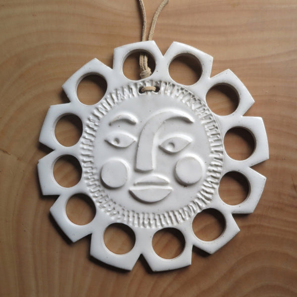 modern artisan sun adornment by MUD IND for FOUND&MADE