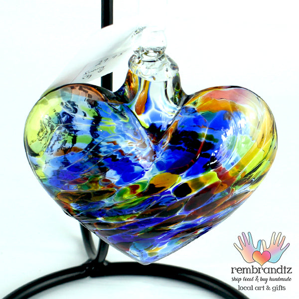 Sunny Sky Handmade Heart Ornament, with swirls of blue and yellow in the glass, ready to hang in a sunny window