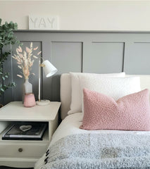 Boucle pillows in pink and cream