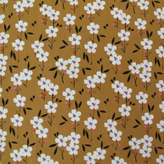 Cotton floral fabric in mustard yellow