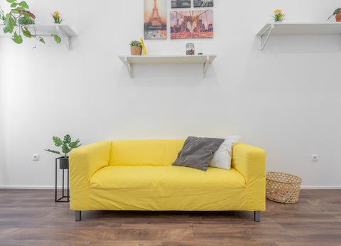 chair covered in yellow linen fabric